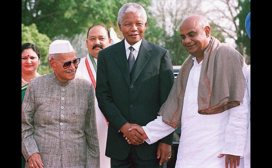 "South African President Nelson Mandela (C) is greeted by Indian counterpart Shankar Dayal Sharma (L) and Prime Minister H.D. Deve Gowda (R) 27 March at Rashtrapati Bhavan Presidential Palace in New Delhi. Mandela, who arrived in New Delhi after attending Bangladesh's independence celebrations, called for the restructuring of the United Nations so that powers are evenly distributed. ""We don't believe a few countries should undermine what the international community decides,"" he said.  AFP"