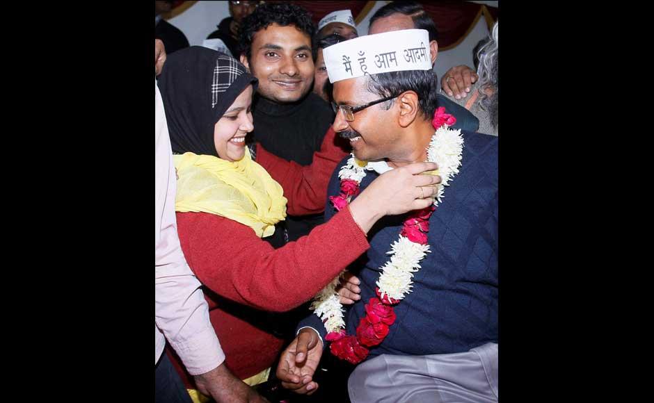 Aam Aadmi Party convener Arvind Kejriwal being garlanded by a party worker after he was elected unanimously by 28 legislators of the Aam Aadmi Party as their leader in the Delhi Assembly, in New Delhi on Monday.  PTI