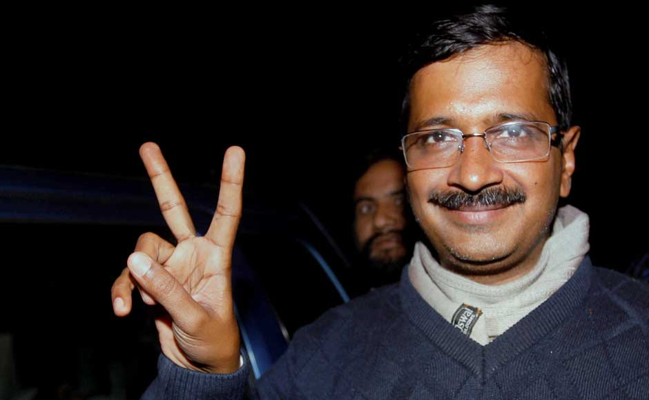 Aam Aadmi Party convener Arvind Kejriwal flashes victory sign as he arrives for a meeting with party MLAs in New Delhi on Monday.PTI