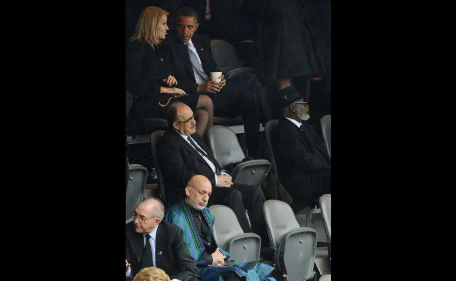 US President  Barack Obama (top R) listens to Denmark's Prime Minister Helle Thorning Schmidt behind Afghan President Hamid Karzai (bottom L) as they attend the memorial service of South African former president Nelson Mandela at the FNB Stadium (Soccer City) in Johannesburg on December 10, 2013. AFP