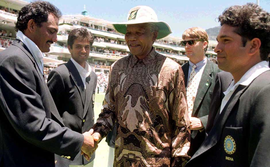 South African President Nelson Mandela (C) is introduced to Mohammad Azharudin (L) by the Indian captain Sachin Tendulkar (R) January 4. Mandela meet both teams during the lunch break on the third day of the second cricket Test match between South Africa and India at the Newlands cricket ground. Reuters