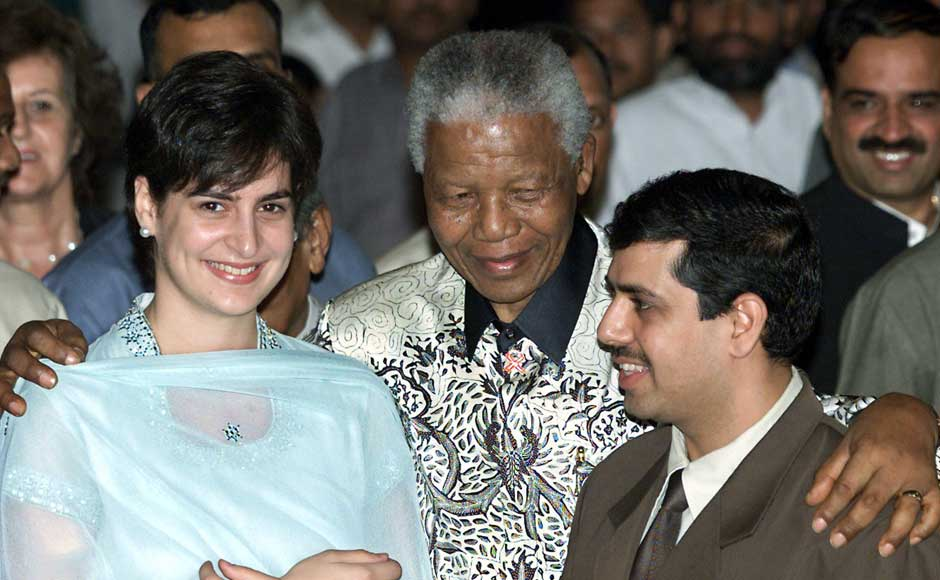 Former South African president Nelson Mandela (C) hugs Priyanka Gandhi, daughter of India's main opposition Congress party president Sonia Gandhi, and her husband Robert Vadra after receiving the Gandhi Peace Prize in New Delhi March 16, 2001. Mandela received the 10-million rupees ($217,391) Gandhi Peace Prize for his non-violent resistance to apartheid. Reuters