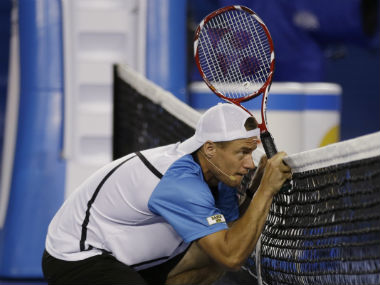 Australia's Lleyton Hewitt ducks as a ball passes above him during an exhibition match on Kids Tennis Day ahead of the Australian Open tennis championship in Melbourne. AP