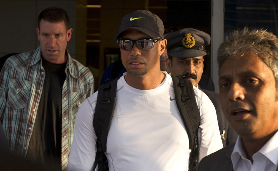 US golfer Tiger Woods (C) arrives at the International airport in New Delhi on February 3, 2014. Tiger Woods is making his first visit to India and will compete February 4, in an 18-hole corporate outing at the Delhi Golf Club. AFP