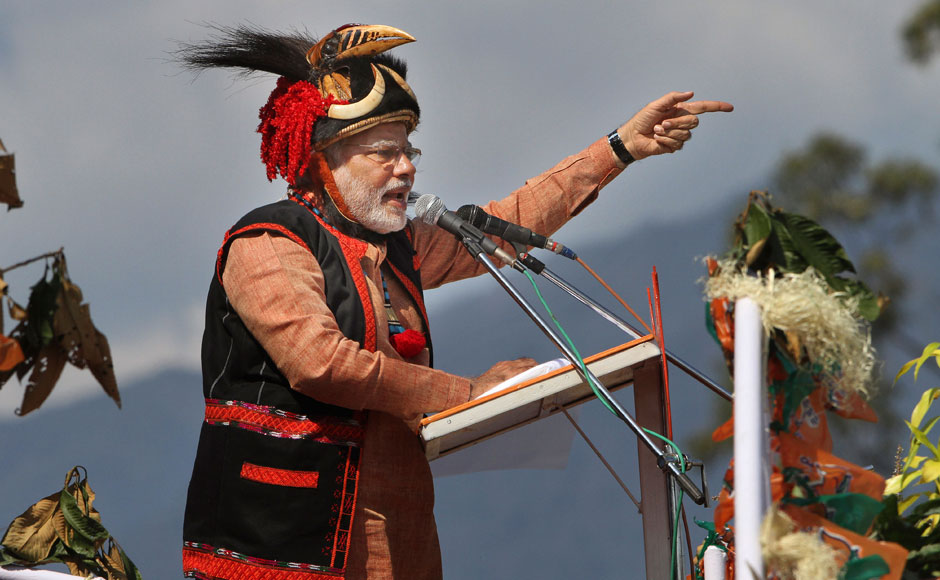 India's main opposition Bharatiya Janata Party (BJP)'s prime ministerial candidate Narendra Modi addresses a gathering at a public rally in Pasighat, India, Saturday, Feb. 22, 2014. AP
