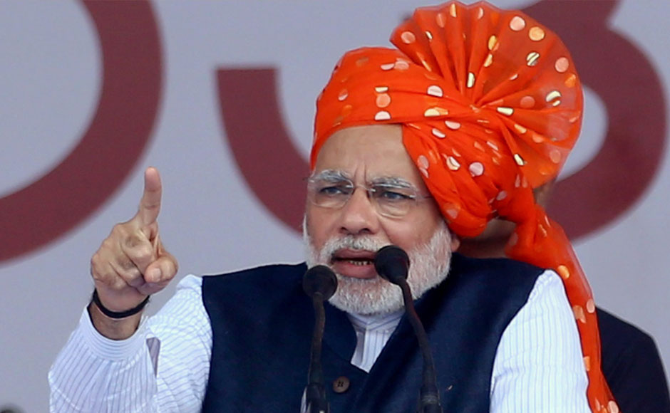 BJP Prime Ministerial Candidate and Gujarat CM Narendra Modi addresses a rally in Davangere, Kartanaka on Tuesday. PTI