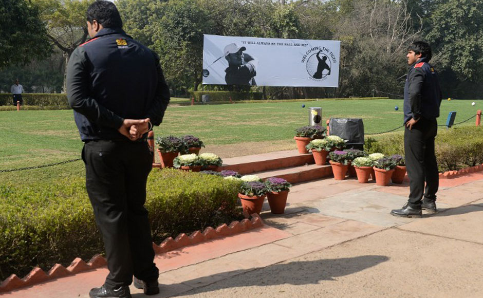 Indian officials walk past a billboard featuring a silhouetted image of US golfer Tiger Woods at The Delhi Golf Club in New Delhi on February 3, 2014. One of India's leading golfers believes Tiger Woods short visit next week to Delhi will generate a long-lasting interest in golf. Woods is visiting the world's largest democratic nation for the first time to compete on February 4, in an 18-hole corporate outing on the Delhi Golf Club in the India capital. AFP