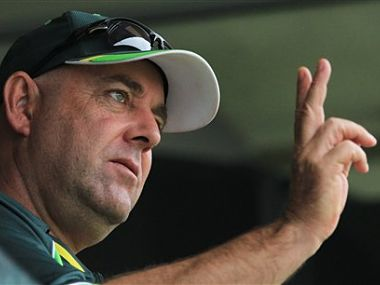 Australian coach Darren Lehmann, gestures to the players from the team pavilion. AP