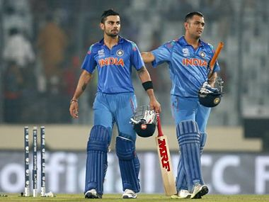 India's captain Mahendra Singh Dhoni, right, and teammate Virat Kohli celebrate their win over Bangladesh in the ICC Twenty20 Cricket World Cup match in Dhaka. AP