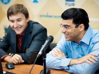 Anand and Karjakin. FIDE