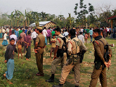 Police officials at a village in Kokrajhar. PTI
