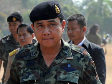 Day after coup Thai army chief summons ousted PM for talks