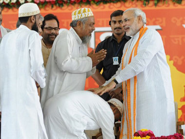 Narendra Modi with Muslim supporters. AFP.