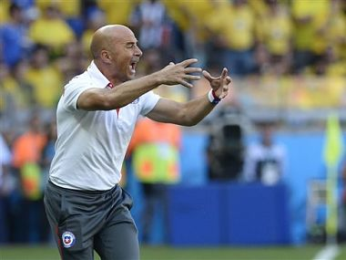 Chile's head coach Jorge Sampaoli yells at his players during the World Cup round of 16 soccer match between Brazil and Chile. AP
