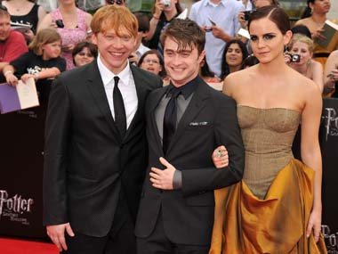 Rupert Grint (left), Daniel Radcliffe (centre) and Emma Watson were some of the stars who attended the ride debut at the theme park. Getty Images