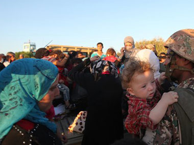 Refugees trying to flee Syria. Agencies.