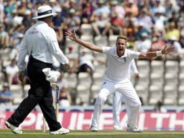 England's Stuart Broad (R) appeals unsuccessfully for the wicket of India's Cheteshwar Pujara to South African umpire Marais Erasmus (L) during play on the third day of the third Test. AFP