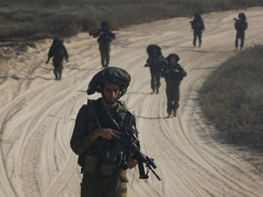 Israeli soldiers patrol outside the northern Gaza Strip. Reuters image
