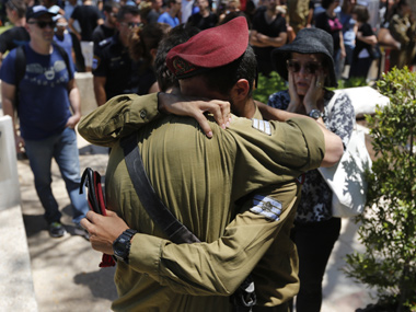 Israeli soldiers mourn during the funeral of their comrade Guy Algranati in Tel Aviv. Reuters image