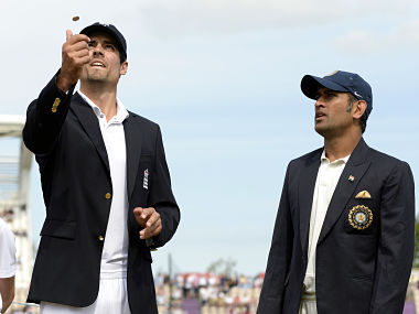 File photo of Alastair Cook and Mahendra Singh Dhoni. Reuters