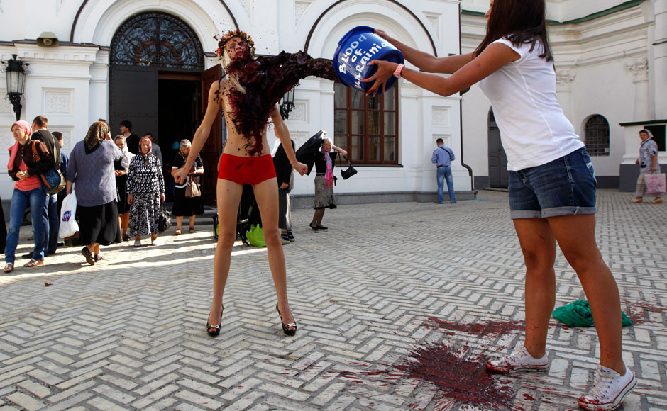 Photos Activists of Ukrainian womens rights group stage topless protest