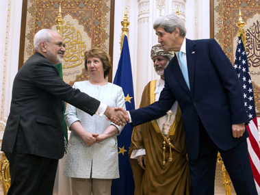 US Secretary of State John Kerry with Iranian foreign minister Javad Zarif in Muscat. Reuters