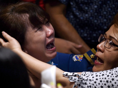 Distraught family members of those who died after AirAsia's QZ8501. AFP