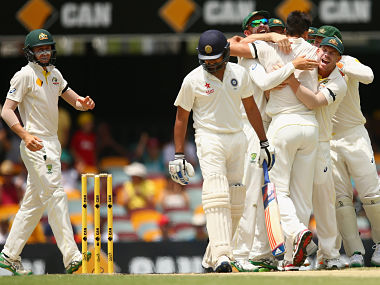 Mitchell Johnson celebrates with team mates after dismissing Rohit Sharma of India during day four of the 2nd Test. Getty