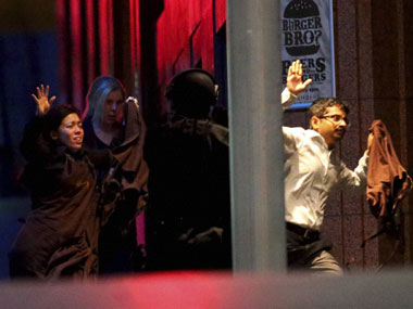 Sydney police absolved of blame for deaths during 2014 cafe siege but accused of delayed response