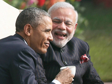 Prime Minister Narendra Modi and US President Barack Obama during their talks over tea at Hyderabad House in New Delhi on Sunday. PTI