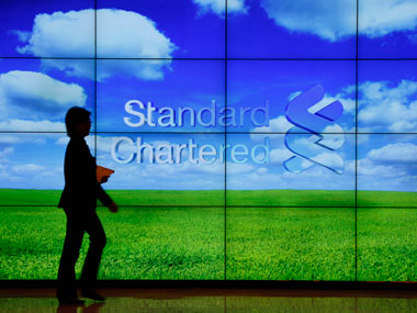 Standard Chartered expected to pay just over 1 billion to resolve US UK probes Report
