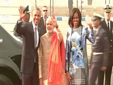 President Obama, along with the First Lady, leaves the airport in his car 'the Beast' after being received by PM Mod