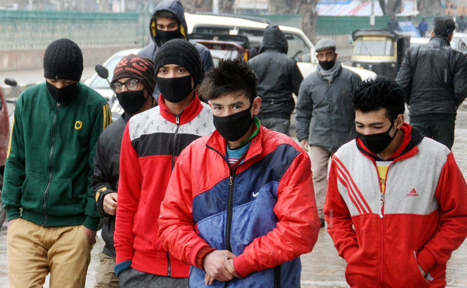 Masks in schools on roads become a common sight as Swine flu spreads