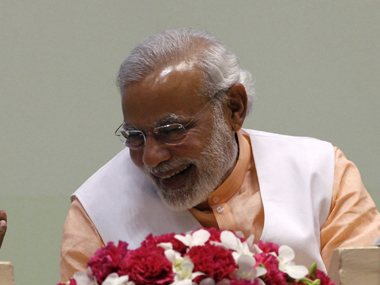 Modi needs to come out of his flashy suit PM Seeks humble tolerant new image after Delhi poll rout