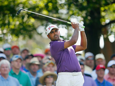 Anirban Lahiri of India watches a tee shot on the fourth hole during the first round of the Masters. Getty