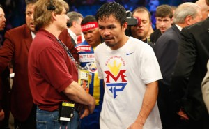 Manny Pacquiao says shoulder injury limited him in Floyd Mayweather loss