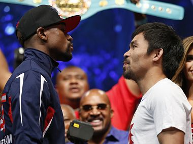 Floyd Mayweather and Manny Pacquiao (right). AP