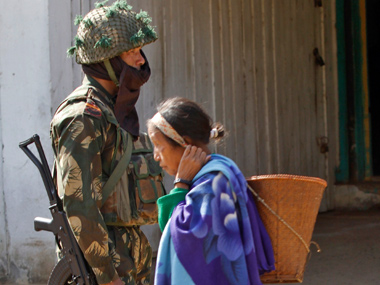 A security personnel stands guard in Manipur. Reuters