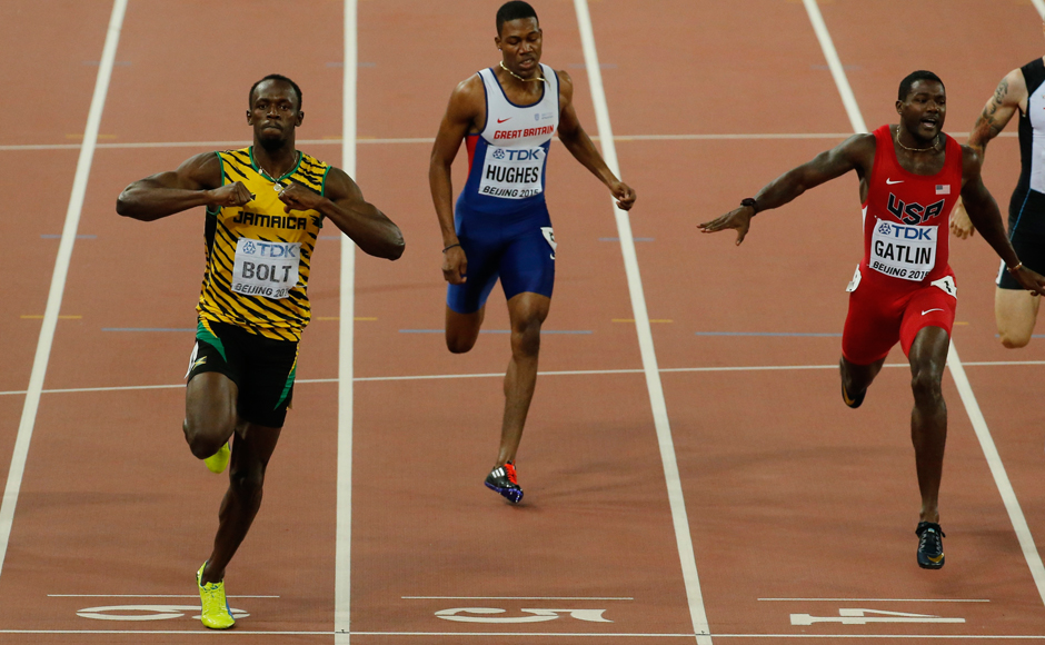 At the double! After 100m gold, Bolt finishes ahead of rival Gatlin in 200m too
