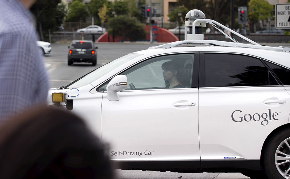 Journalists take a test drive in a self-driving Lexus SUV during a media preview of Google's prototype autonomous vehicles in Moutain View, California September 29, 2015. REUTERS