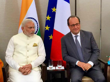PM Modi with President Hollande. Image Courtesy: Twitter/ @MEAIndia