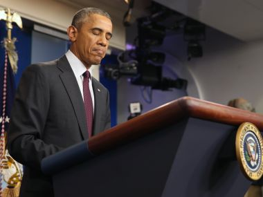 In familiar ritual Obama visits and consoles families of Oregon shooting victims