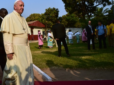Pope Francis arrives at the Evangelic community in Bangui on Sunday. AFP