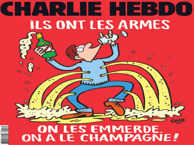 """""""Screw them, we have the champagne."""" Charlie Hebdo's cover after the Paris attacks"""