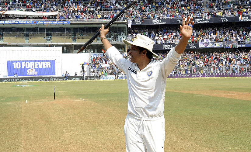 Sachin Tendulkar waves to the crowd before walking off the Wankhede pitch for the last time. BCCI