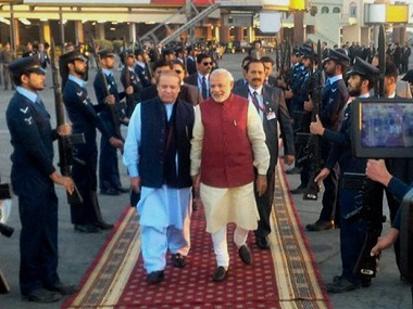 Prime Minister Narendra Modi is received by his Pakistani counterpart Nawaz Sharif upon his arrival in Lahore. PTI / Twitter @MEAIndia