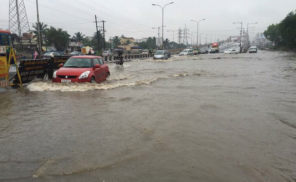Chennai drenched: Cars submerged, roads dug up and continuous, heavy rain