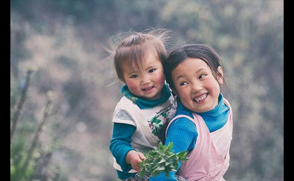 Praveen shot this image on his travel to Lava, a small tourist destination in Kalimpong, famous for its natural beauty. He was drawn to the sheer beauty and innocence smile of this kids. Praveen Chetri, 27 years, Freelance Photographer