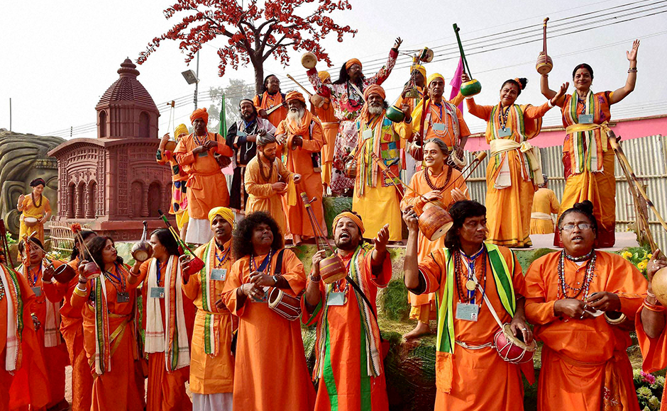 West Bengal artists pose in front of their tableau for the Republic Day parade during a press preview in New Delhi on Friday. PTI Photo by Kamal Kishore
