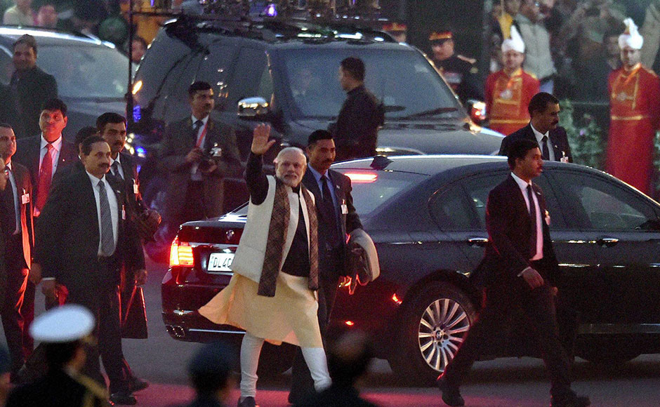 Prime Minister Narendra Modi waves as he leaves after attending the Beating Retreat ceremony at Vijay Chowk in New Delhi on Friday. PTI Photo by Kamal Singh
